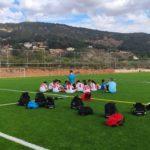 Benjamín A del Aspe Unión Deportiva escuchando a su entrenador antes de iniciar el encuentro